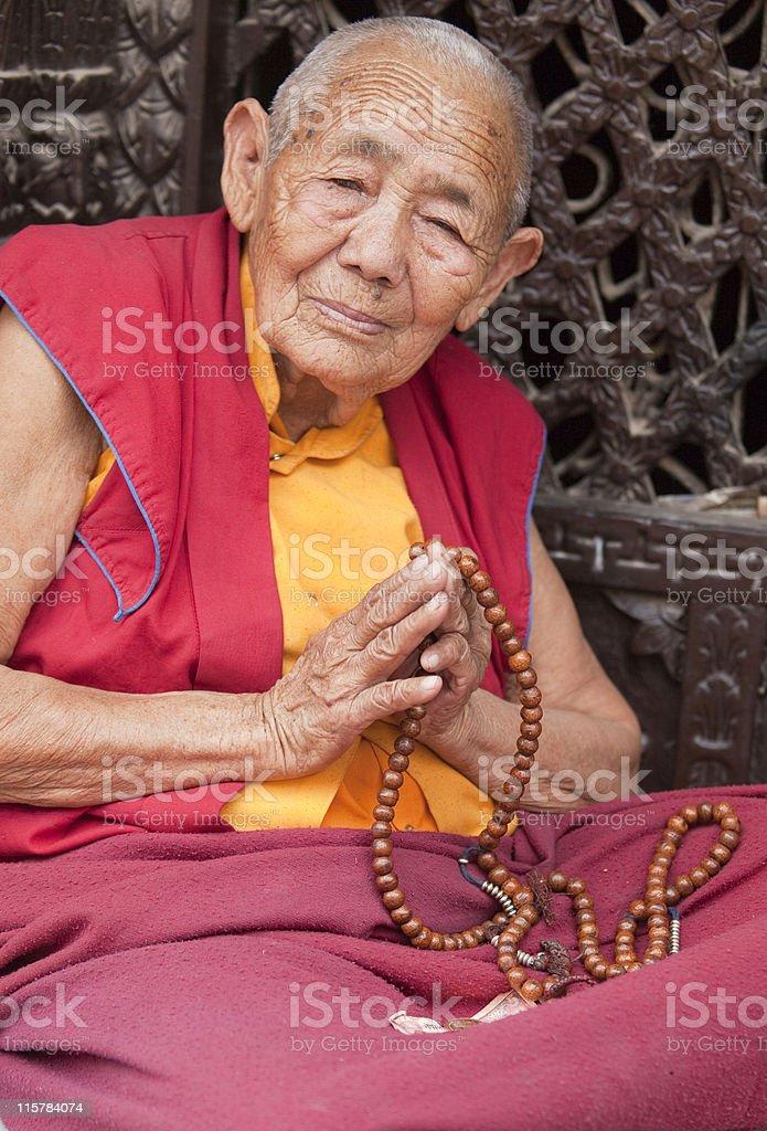 Monk with Mala Prayer beads stock photo