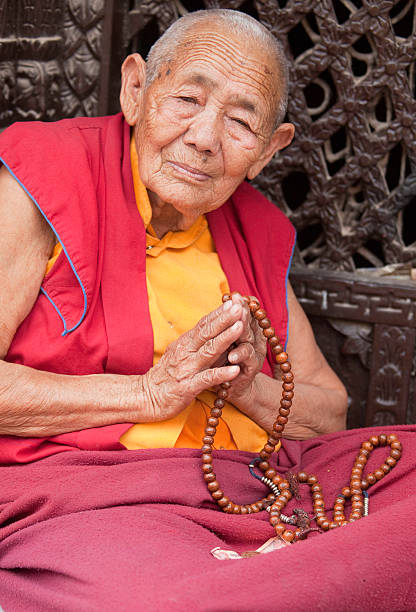 Monk with Mala Prayer beads stock photo