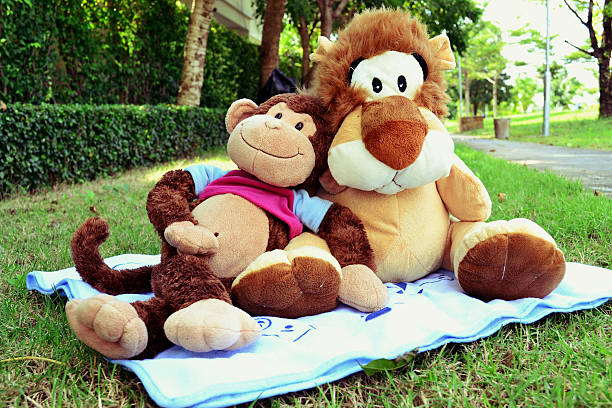 Monkey and lion doll are hugging and sitting in garden picture id498494400?b=1&k=6&m=498494400&s=612x612&w=0&h=b4md3pcnysqrehf 6bypotwqh nbapxul3m  lpj4 e=