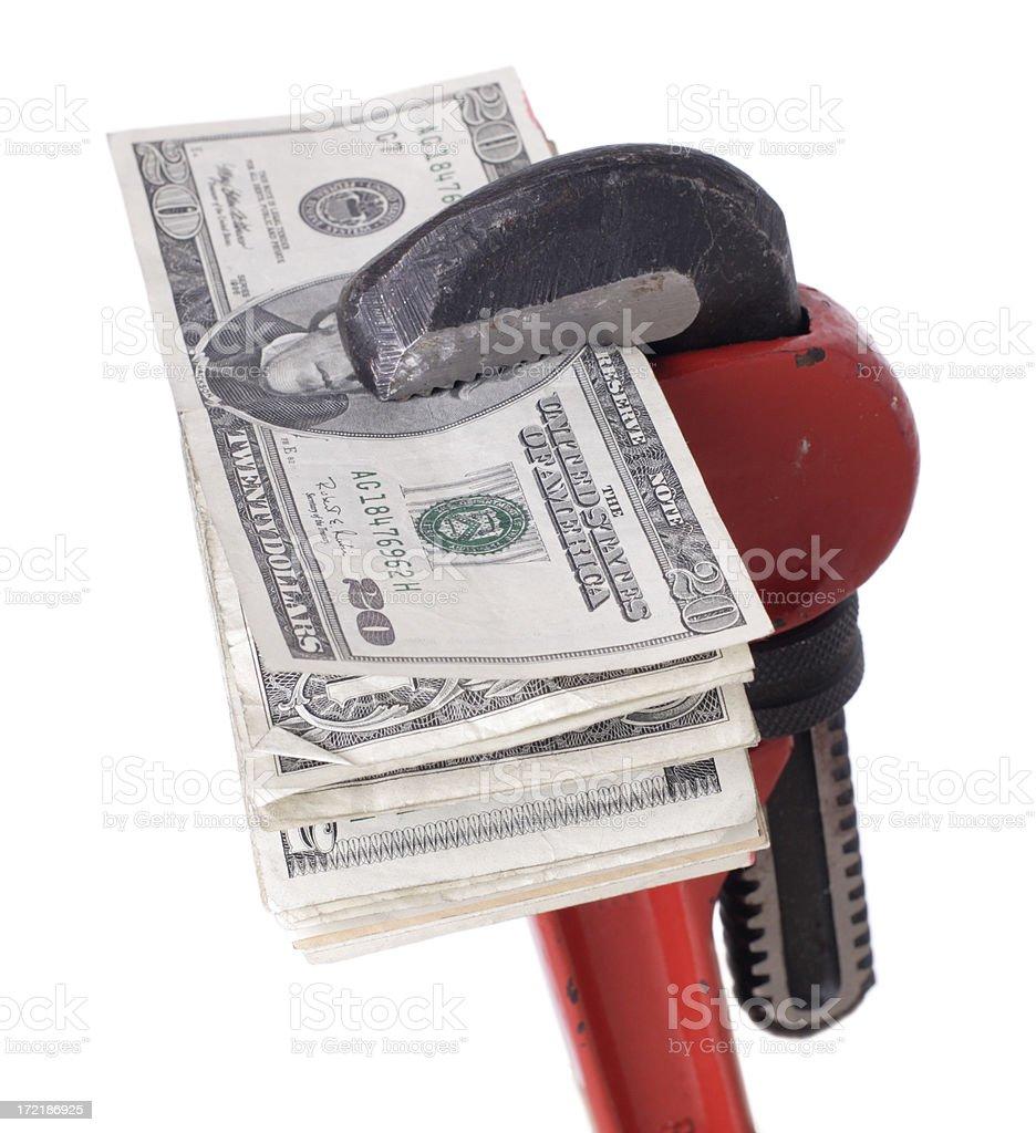 Monkey Wrench Squeezing Money Isolated on White royalty-free stock photo