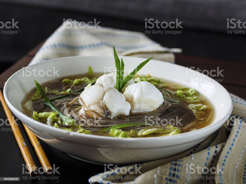 Monkfish broth with soba noodles and Chinese leaves royalty-free stock photo