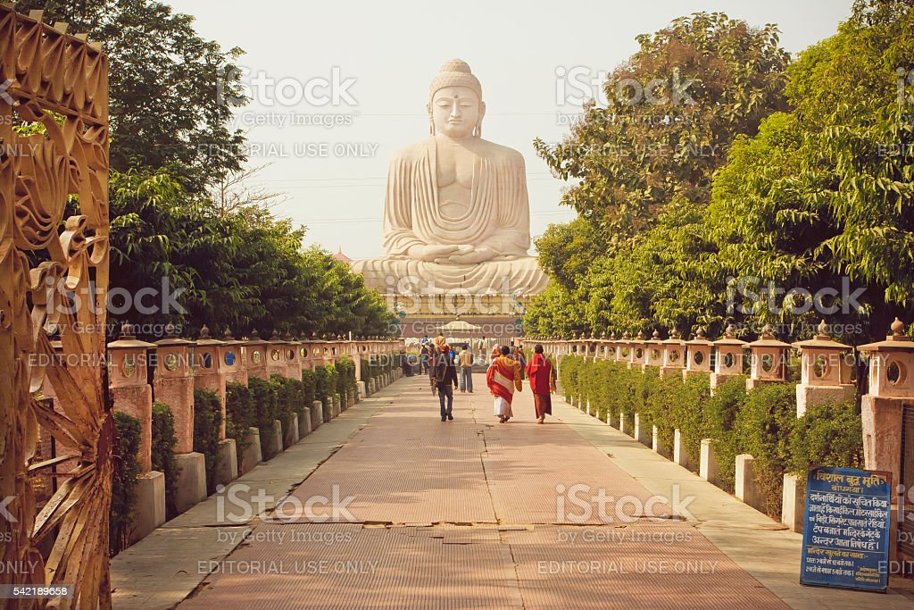 Monks and other people rushing to Buddha statue stock photo