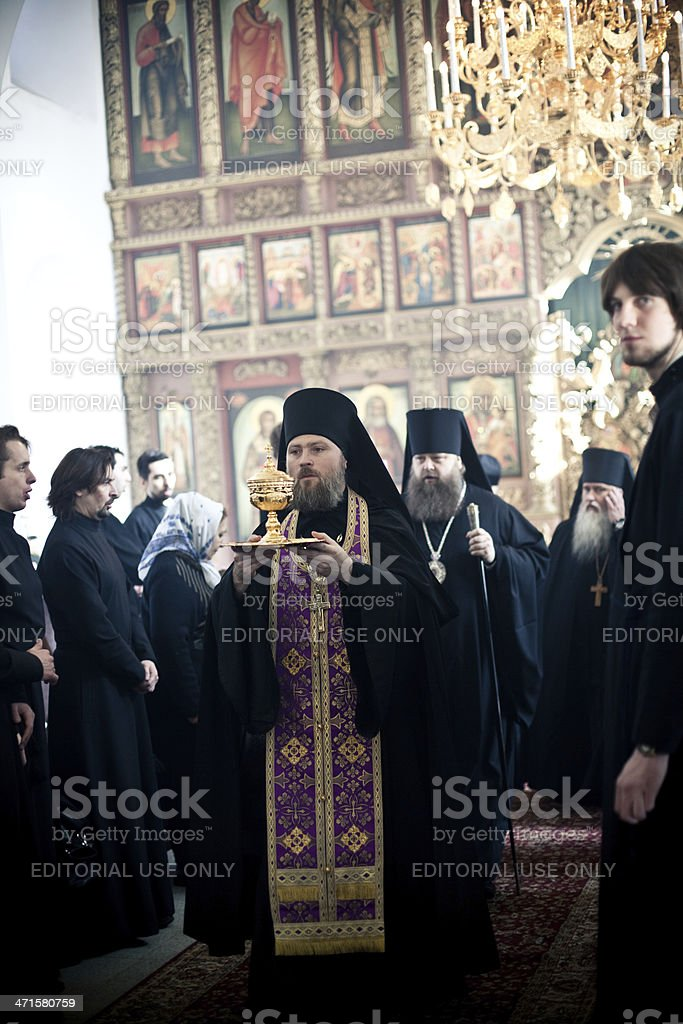 Monks and priests leave church after the Orthodox liturgy royalty-free stock photo