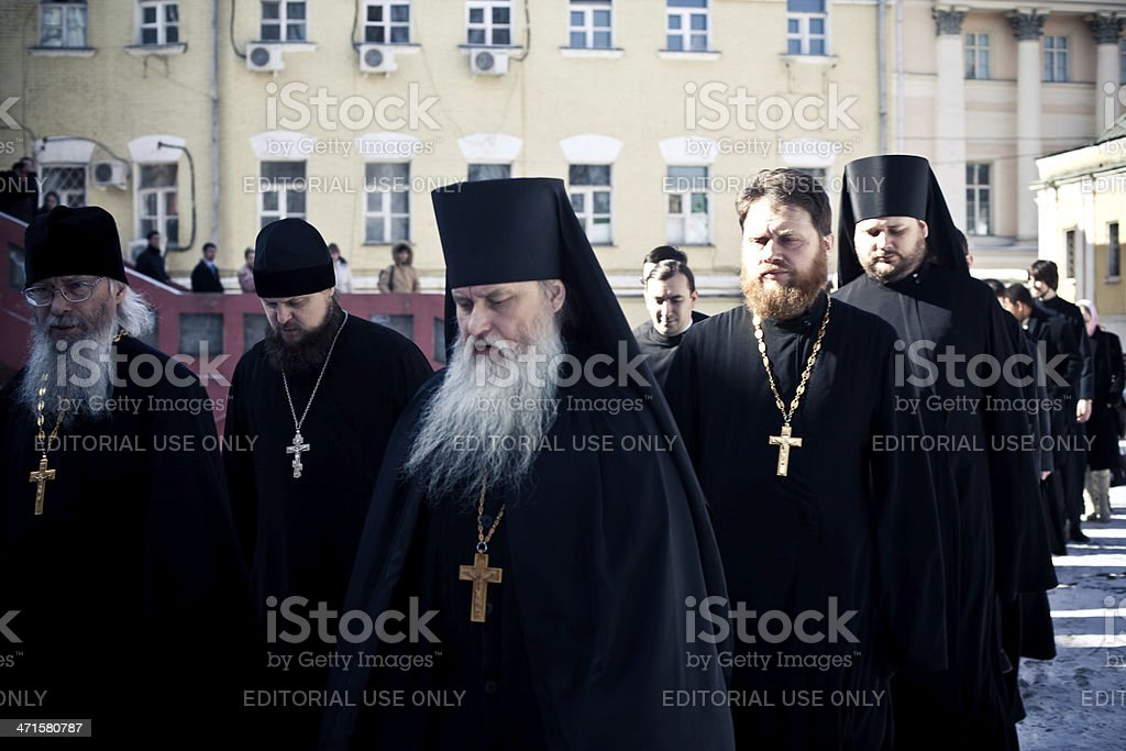 monks and priests walk after the Orthodox liturgy royalty-free stock photo