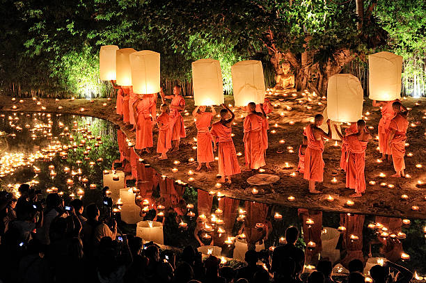 Monks at Phan Tao temple during the Loi Krathong Festival. Chiang Mai, Thailand - November 28, 2012: Traditional monk lights floating balloon made of paper annually at Wat Phan Tao temple during the Loi Krathong Festival. chiang mai province stock pictures, royalty-free photos & images