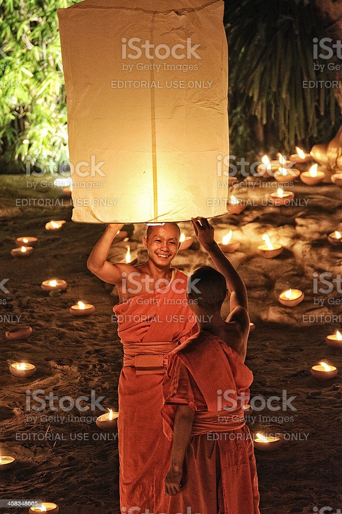 Monks at Phan Tao temple during the Loi Krathong Festival. stock photo