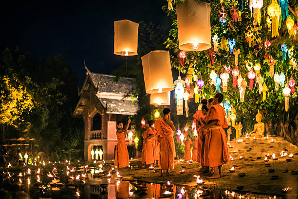 Monks at Phan Tao temple during the Loi Krathong Festival Chiang Mai, Thailand - November 24, 2015: Traditional monk lights floating balloon made of paper annually at Wat Phan Tao temple during the Loi Krathong Festival. chiang mai province stock pictures, royalty-free photos & images