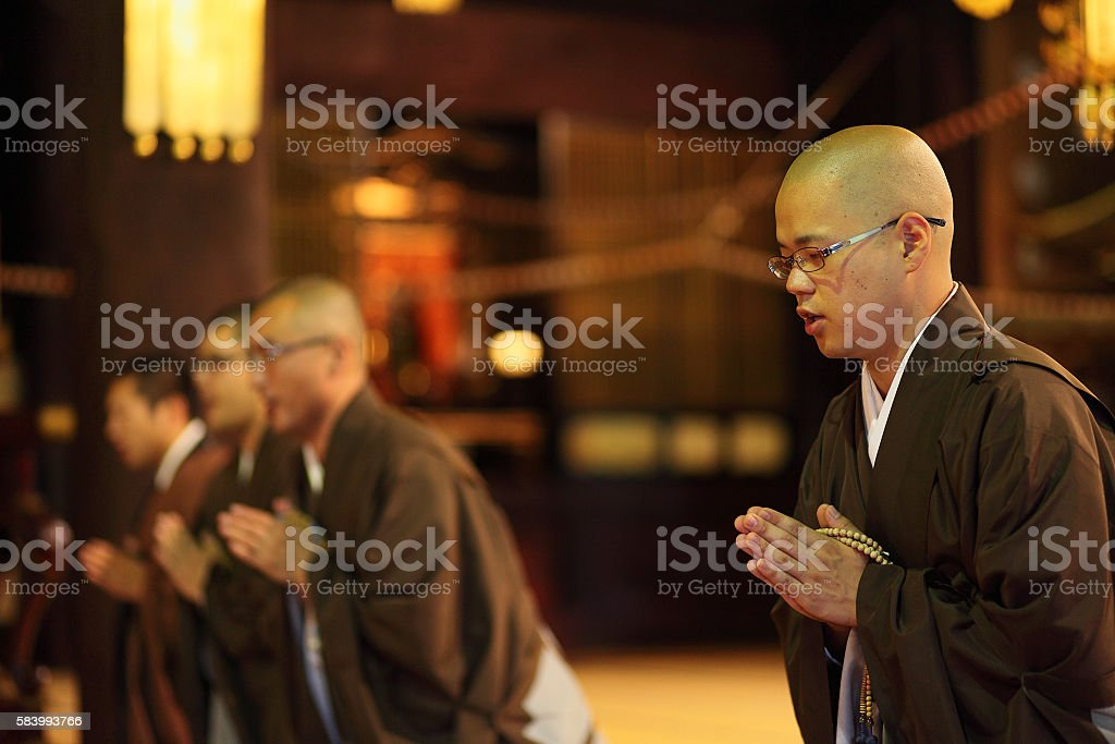 monks chanting in temple,Chion-ji,Kyoto stock photo