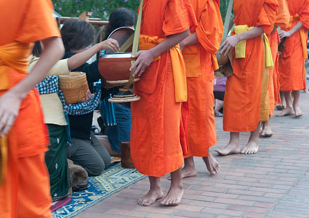 Monks Collecting Alms in Luang Prabang, Laos stock photo