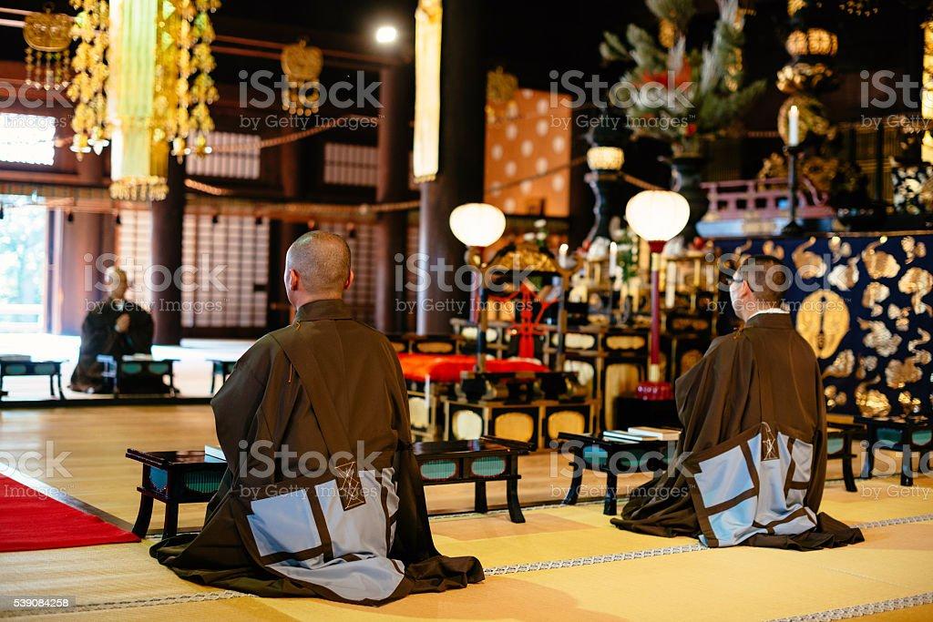 Monks during prayer in Buddhist shrine in Kyoto stock photo