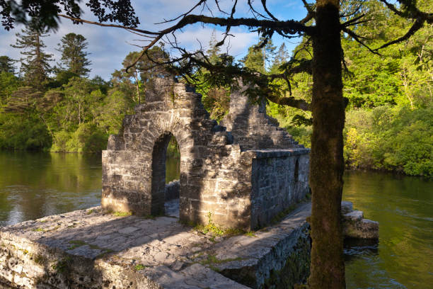 Monk's Fishing House, Cong, County Mayo, Ireland A 13th Century ruin on the Cong River.  The elegant arched entrance to the Monk's Fishing House, part of Cong Abbey, County Mayo, Ireland michael stephen wills cong stock pictures, royalty-free photos & images