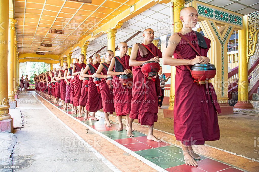 Monks going for lunch in the monastery from Bago Myanmar stock photo