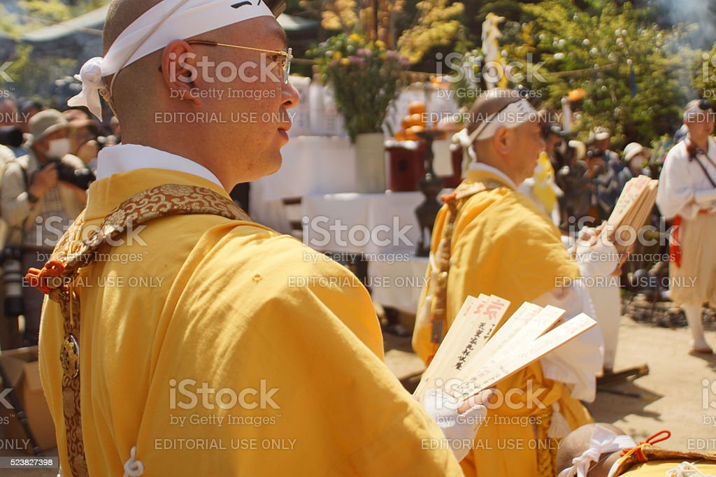 Monks holding wishes at Fire Walking Festival in Miyajima stock photo