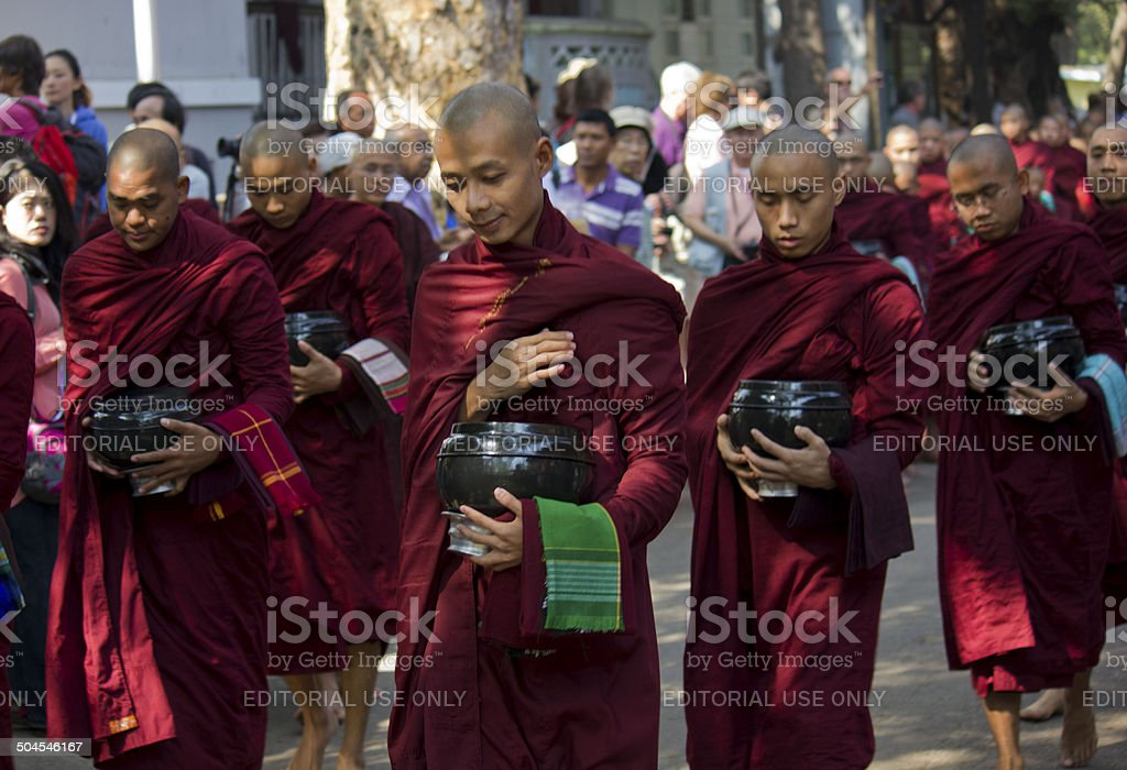 Monks in a row at Mahagandayon Monastery stock photo