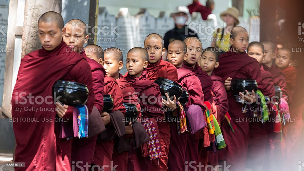 Monks in a row at Mahagandayon stock photo