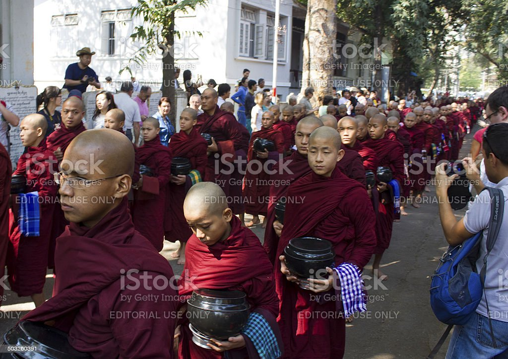 Monks in a row: Mahagandayon Monastery stock photo