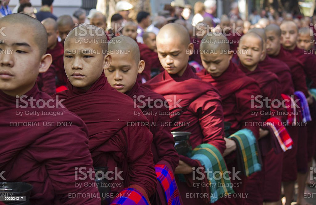 Monks in a row: Mahagandayon Monastery. stock photo