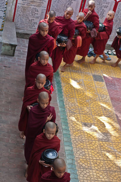 Monks in the line for food during the biggest lunch of Buddhist monks in the world stock photo