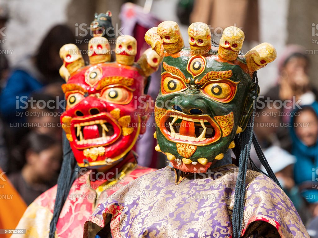 Monks perform a religious mask dance of Tibetan Buddhism stock photo
