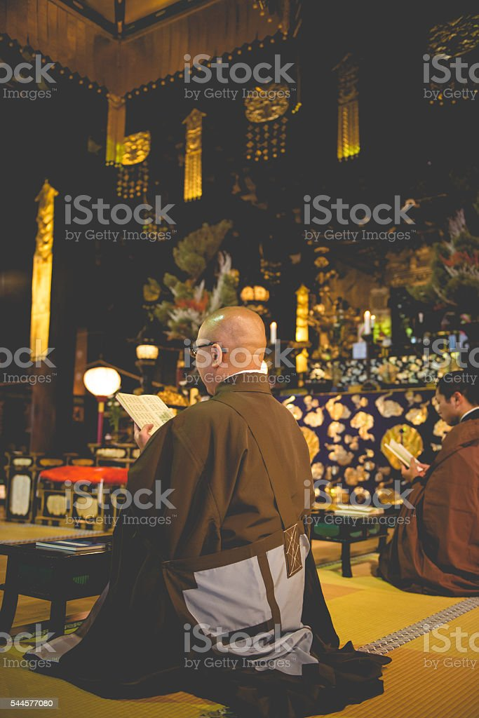 Monks Praying at Chion-ji Temple in Kyoto, Japan stock photo