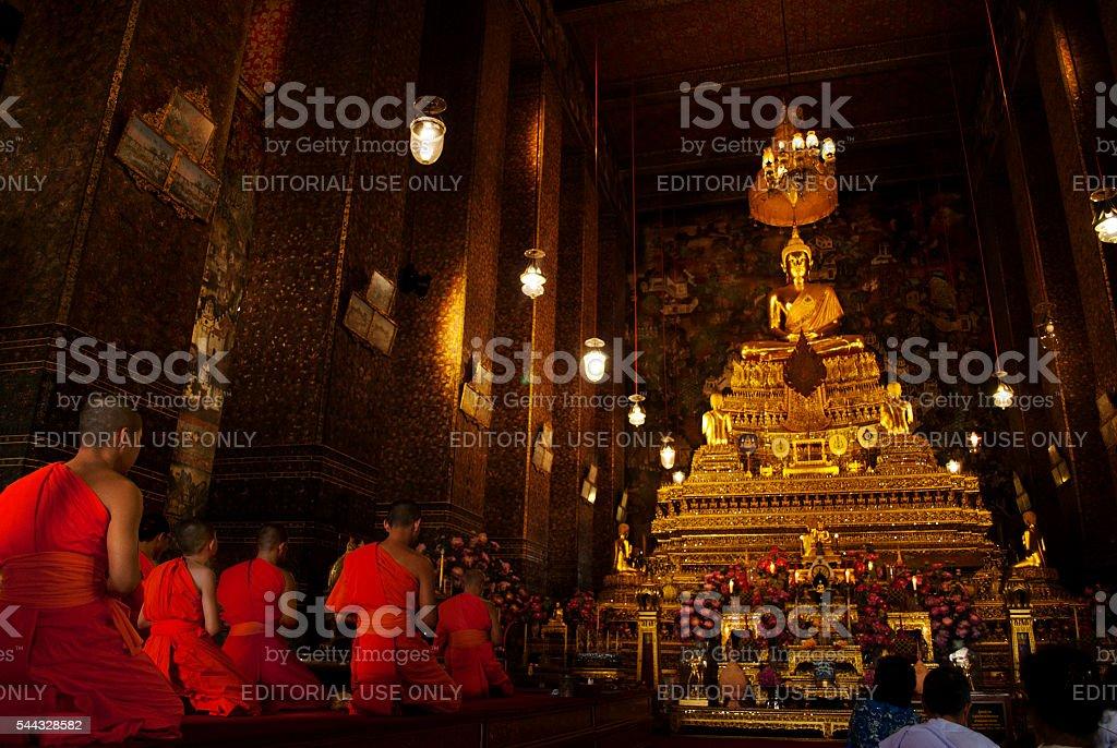 Monks praying at Wat Pho, Bangkok stock photo
