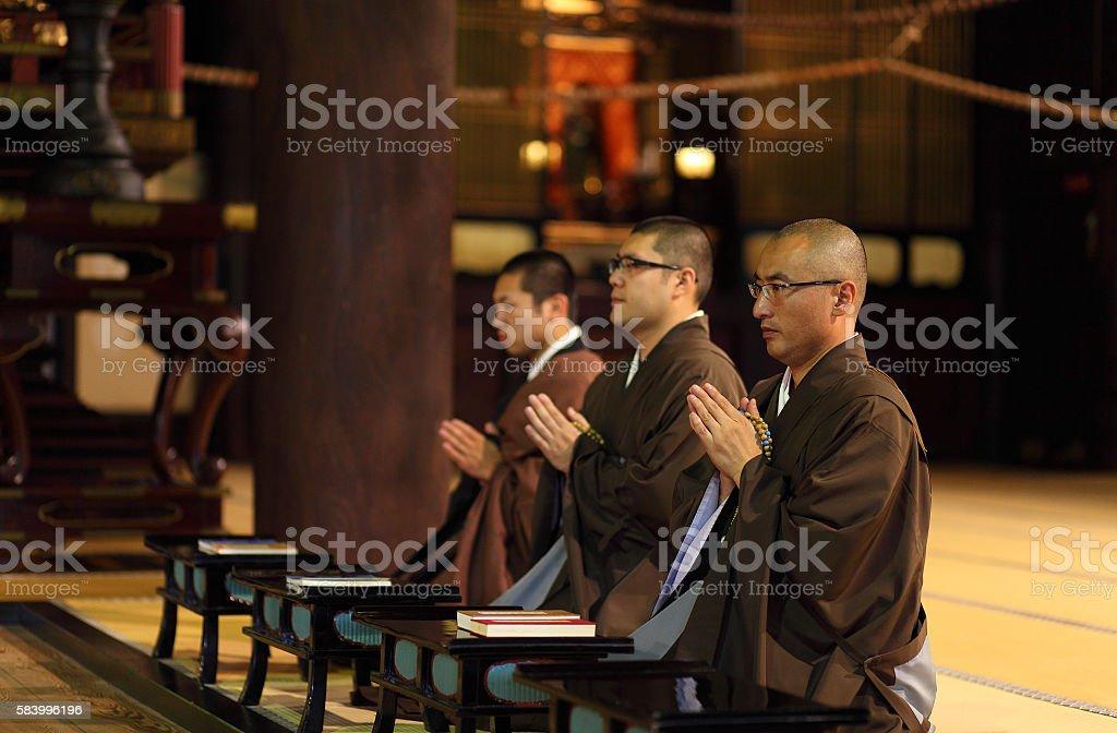 monks praying in temple,Chion-ji,Kyoto,Japan stock photo