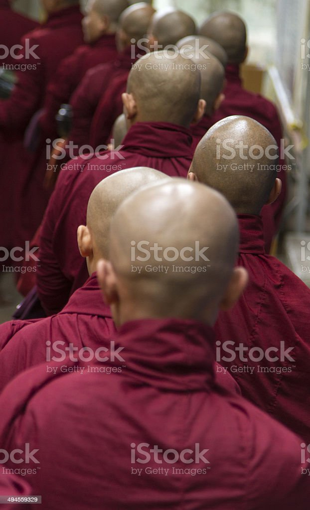 Monks queuing up for food stock photo