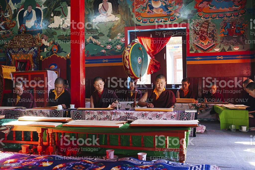 Monks (nuns) reading the ancient buddhist manuscript royalty-free stock photo