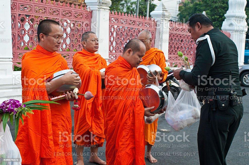 Monks receiving alms, Wat Benjamabophit, Bangkok, Thailand stock photo