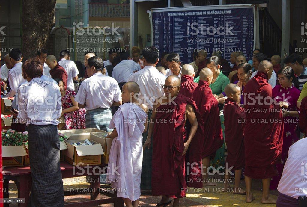 Monks receiving charity at Mahagandayon Monastery stock photo