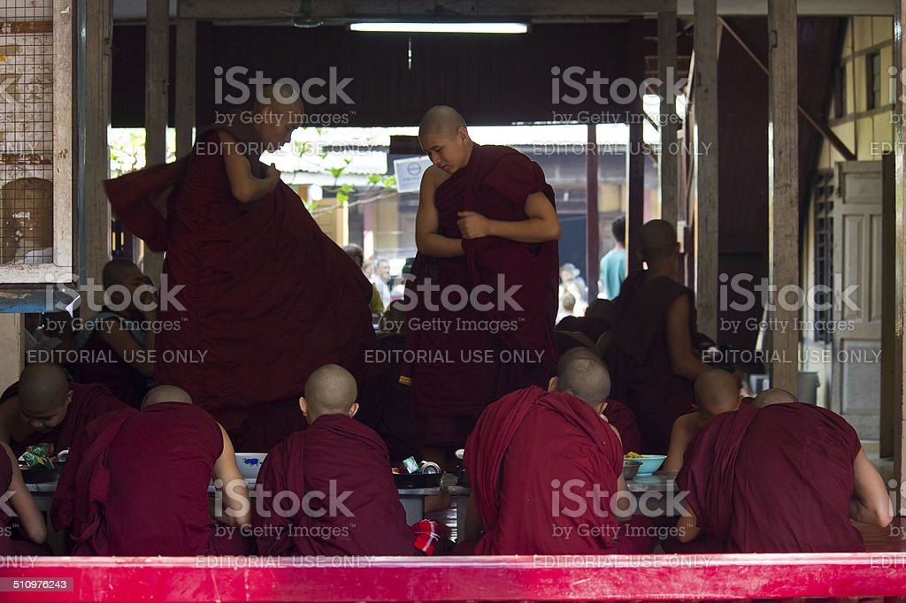 Monks sitting for lunch stock photo