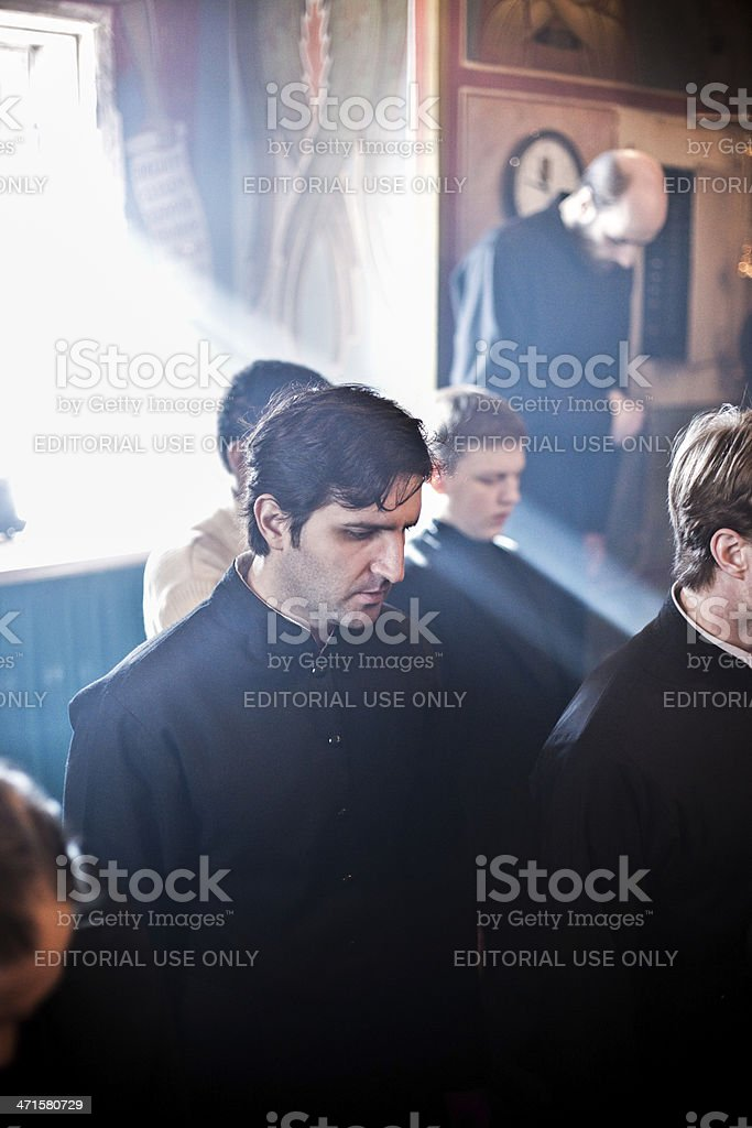 monks stand on kneels and sing in sanctuary royalty-free stock photo