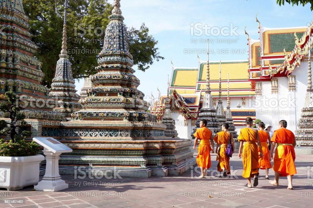 Monks walking at the Wat Arun temple, Bangkok stock photo