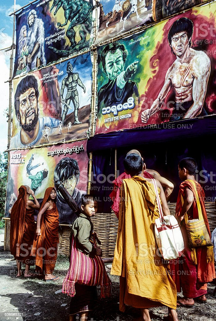 monks watch the advertising of a cimena stock photo