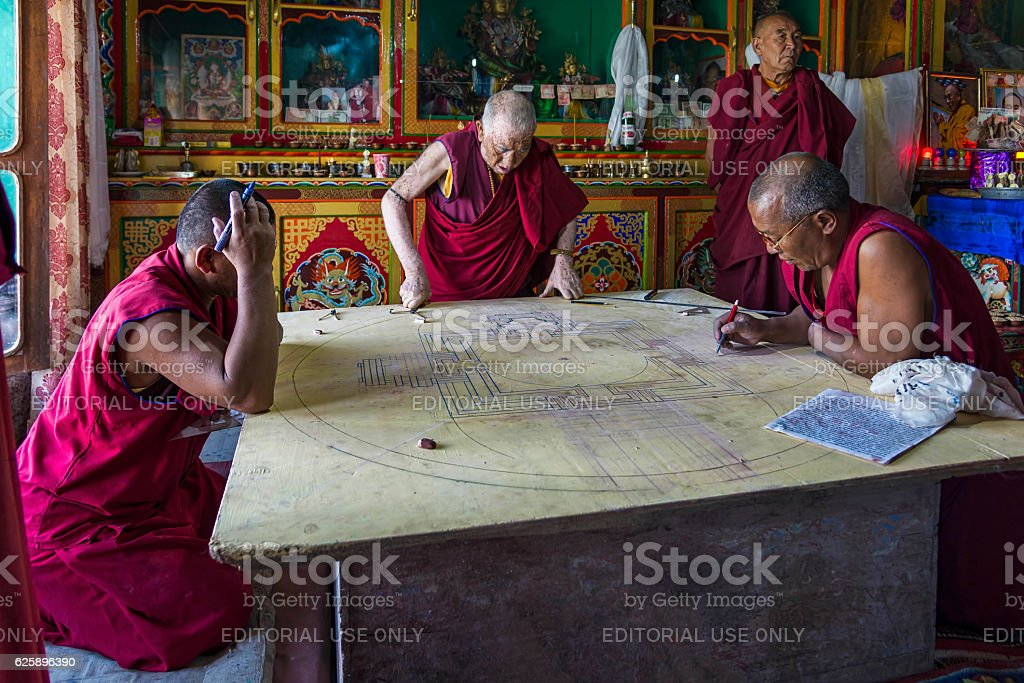 Monks working on mandala in Diskit monastery, Ladakh stock photo