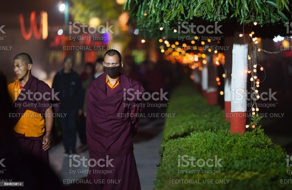 Monks-pilgrims make evening kora. stock photo