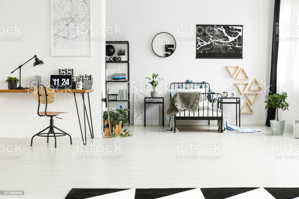 Monochromatic bedroom with blue accents stock photo