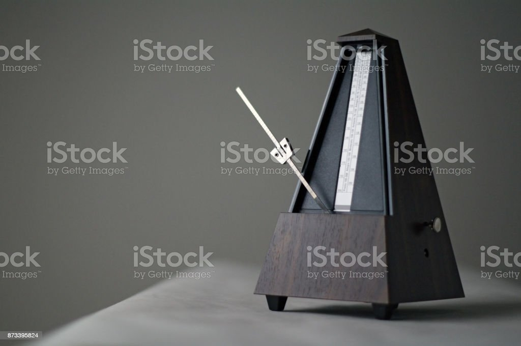 Monochromatic metronome in action isolated and on a plain background stock photo