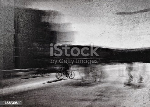 812812808 istock photo Monochrome blurred motion view of the cyclist in the street 1133239812