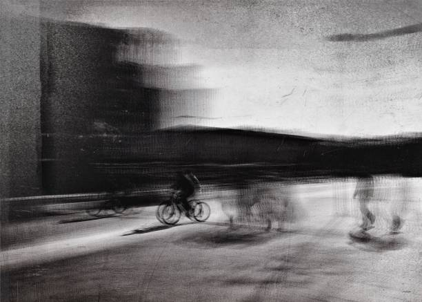 Monochrome blurred motion view of the cyclist in the street