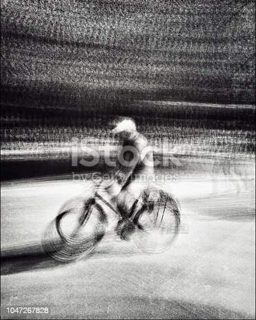 812812808 istock photo Monochrome blurred motion view of the cyclist on the street 1047267828