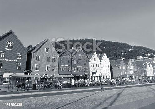 Bergen, Norway - July 21, 2013 : Monochrome Bryggen Hanseatic Wharf with many Visitors, the Landmark of Bergen, Norway, Scandinavia