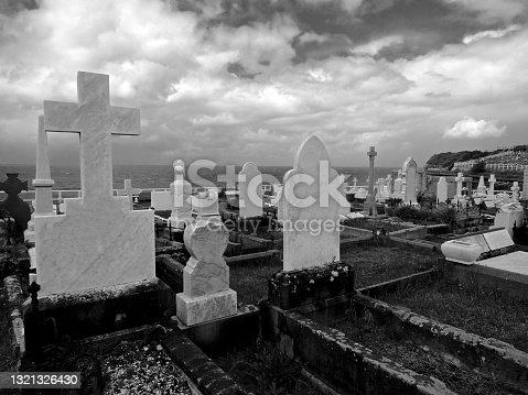 istock Monochrome cemetery by the sea 1321326430