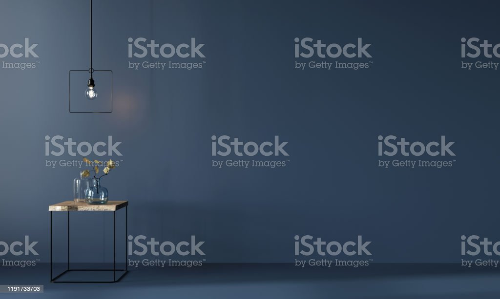 Monochrome dark blue interior with minimalistic wooden table Monochrome navy blue interior with minimalistic wooden table, chandelier and glass vases with leaves / 3D illustration, 3d render Autumn Stock Photo