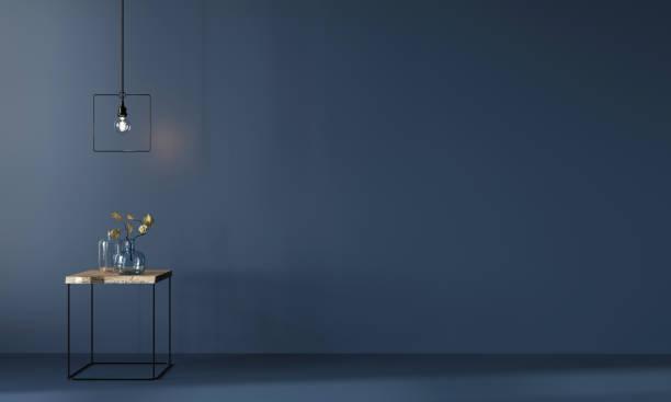 Monochrome dark blue interior with minimalistic wooden table stock photo