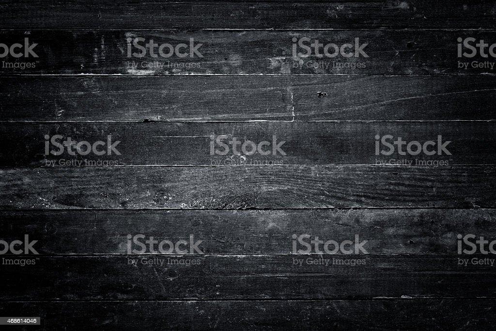 Monochrome dark wooden table stock photo