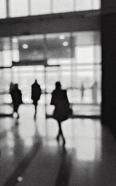 Monochrome defocused view of the people in the building