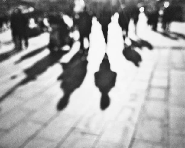 Monochrome defocused view of the people walking on the street