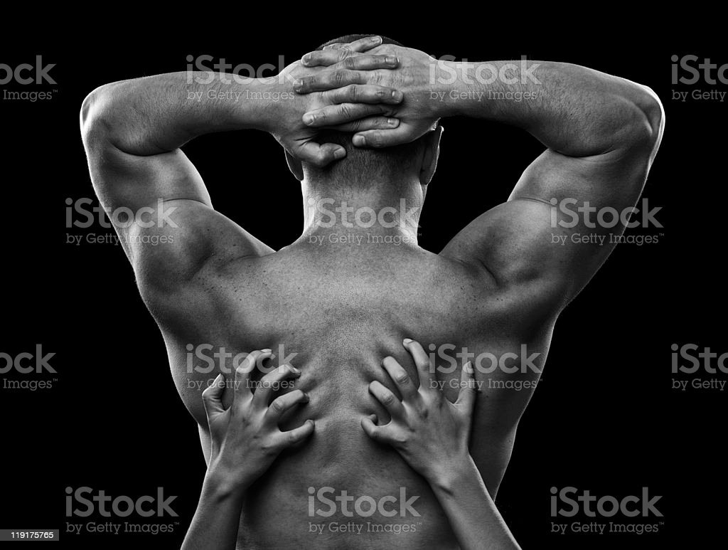 Monochrome image of a man's back and woman's hands royalty-free stock photo
