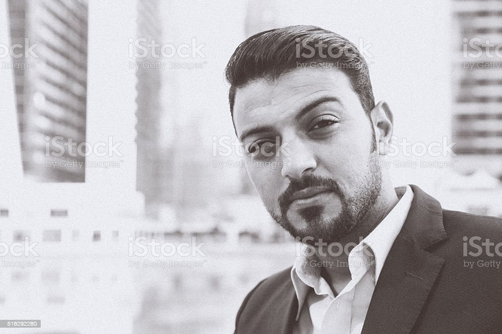 Monochrome Image of a Wealthy businessman smiling towards the camera stock photo
